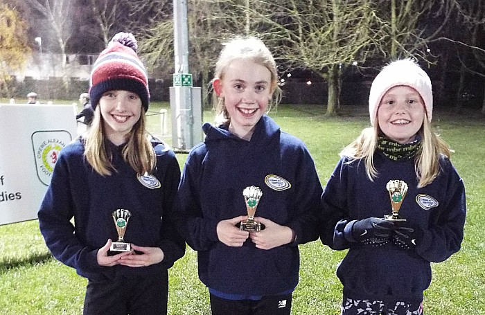 U11 girls team second Lucy Salter Sophie Harding and Ruby Johnson