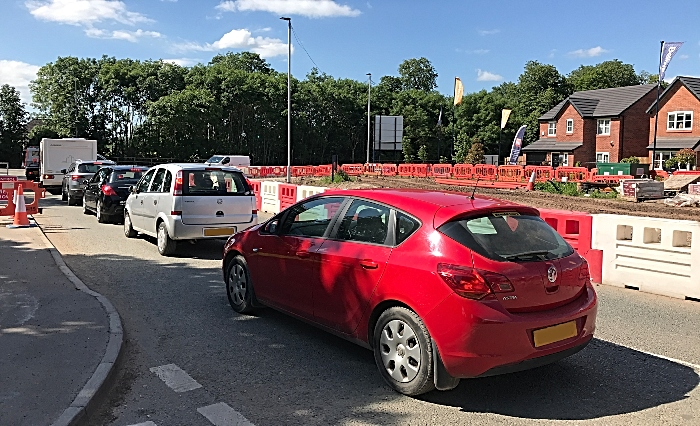 Vehicles wait to exit the A530 (Middlewich Road)-Wistaston Green Road junction (1)