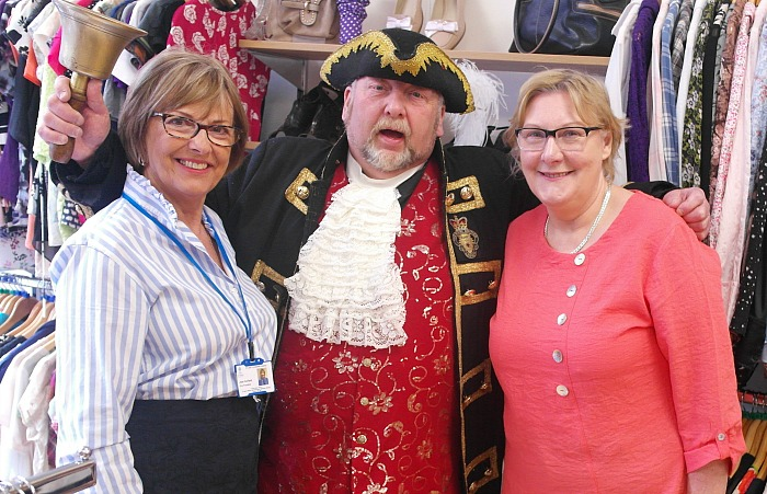 Nantwich Town Crier with staff at St Luke's Hospice charity shop