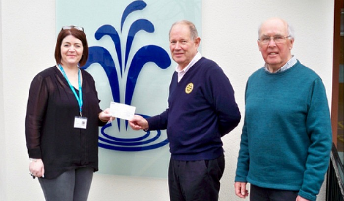 Vicky Baddeley from St. Luke's, Nantwich rotarians The Rotary Club of Nantwich President Rod Stokes and Rotarian John Meadows with the cheque for £700