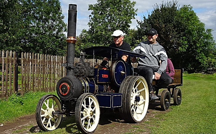 Visitors enjoy a ride on miniature 4-inch scale steam traction engine Maud (2)