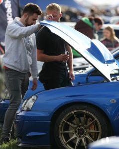 RallyFest - Visitors inspect a Subaru sports car