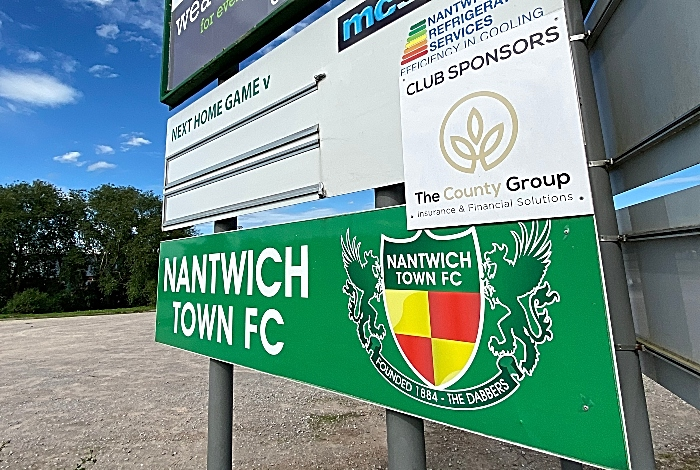 positive test Weaver Stadium - Nantwich Town Football Club - next home games sign
