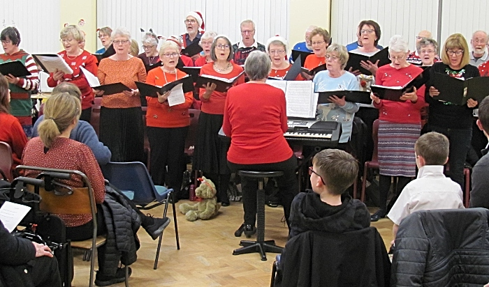 Wells Green Choir led by Myra Wood perform at the concert - community council