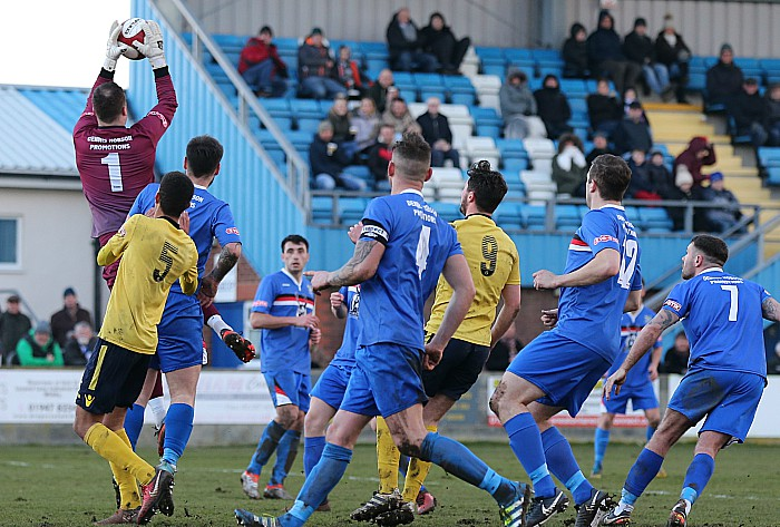 Whitby goalkeeper Jack Norton collects the ball