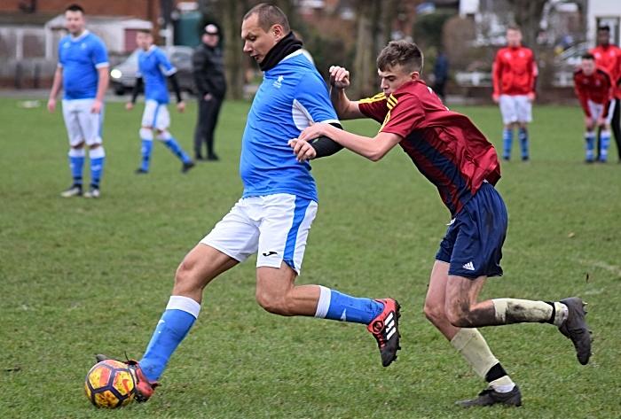 Willaston White Star player keeps the ball under pressure (1)