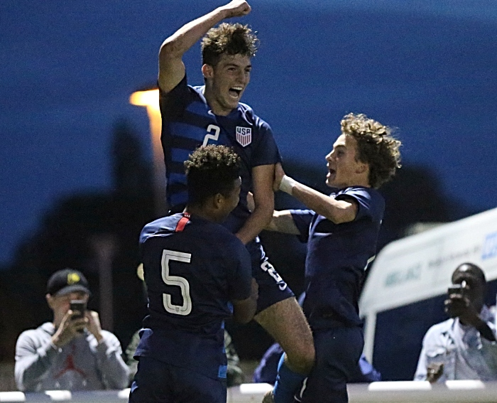USA Winning goal - Joe Scally scores from the penalty mark and celebrates with teammates (1)