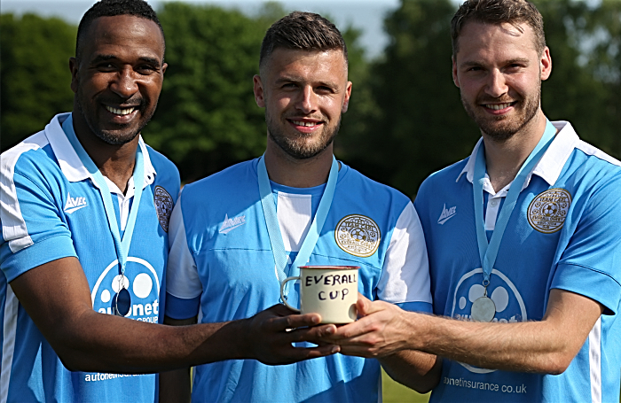 charity game - Winning team captain Carl Everall -centre- with teammates Ricardo Fuller and Nick Powell and the Everall Cup