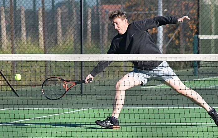 tennis - Wistaston A vs Holmes Chapel A - Chris Raiswell stretches for the ball (1)