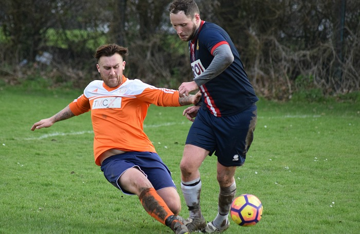 Wistaston Athletic player clears the ball