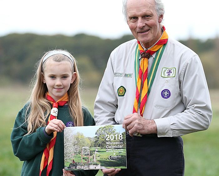 Wistaston Scout Group l-r Emma Bowkett (Cub) and Gerald Newbrook (Honorary President) with the 2018 Wistaston Calendar