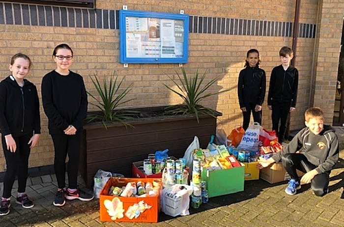 Year 6 pupils at Pear Tree with their Harvest contributions to the Nantwich Foodbank (1)