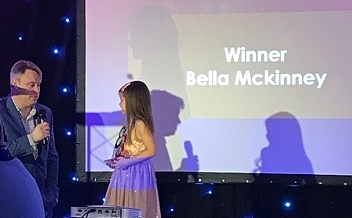 bella mckinney collecting her award