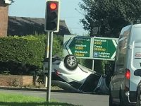 Police probe crash which left car on roof near Nantwich
