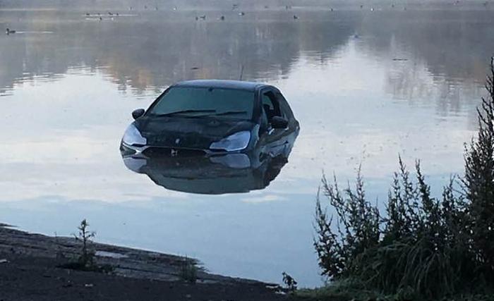 car in nantwich lake 1 - by Kath Edwards