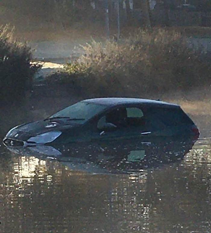car in nantwich lake 2 - by Kath edwards