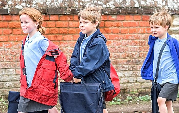 children walking to school - gates