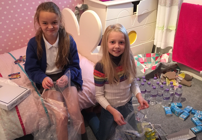 daisy and mia bagging up all goods collected