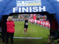 Athletes take on Cheshire Triathlon in wind and rain