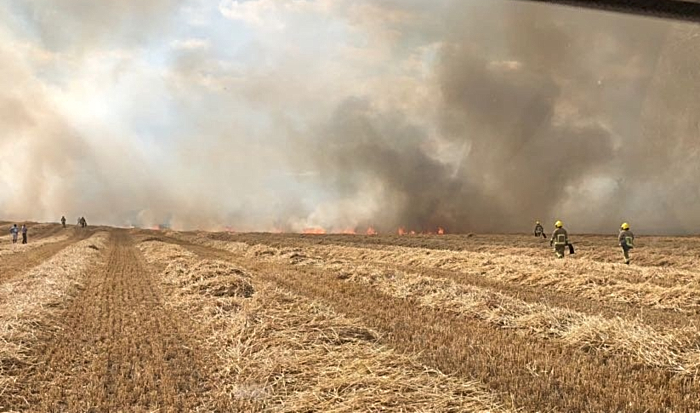 fire crews tackle farmland blaze at Burleydam