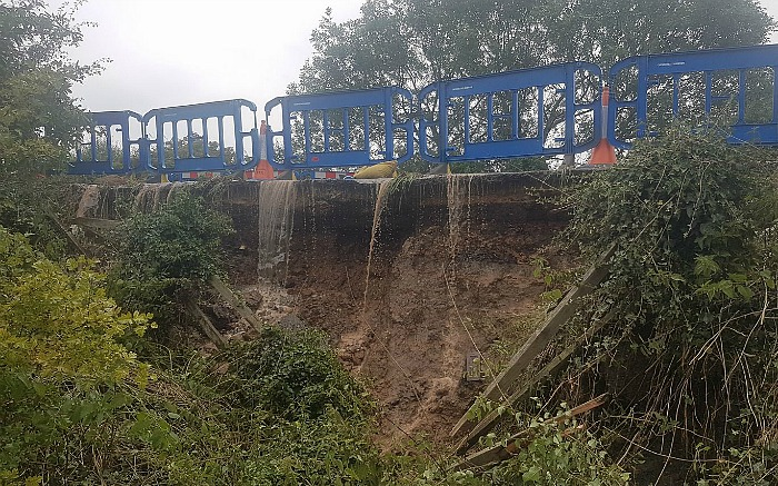 flood damage to A530 caused by burst water main on Middlewich Road