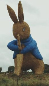 full length peter rabbit straw statue