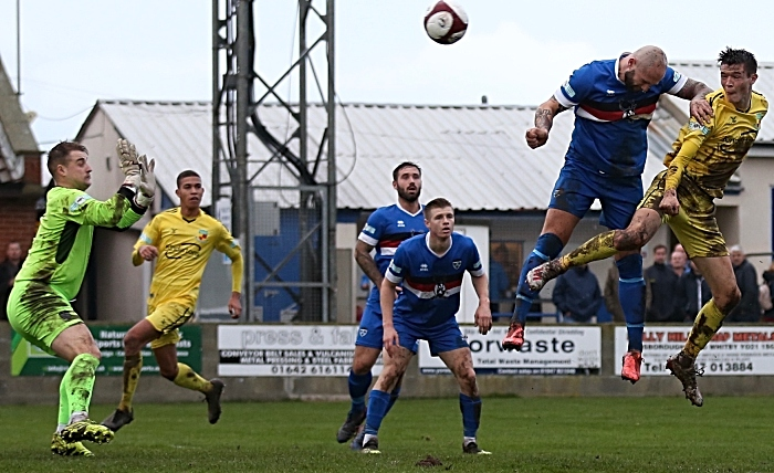 header by malkin against whitby town