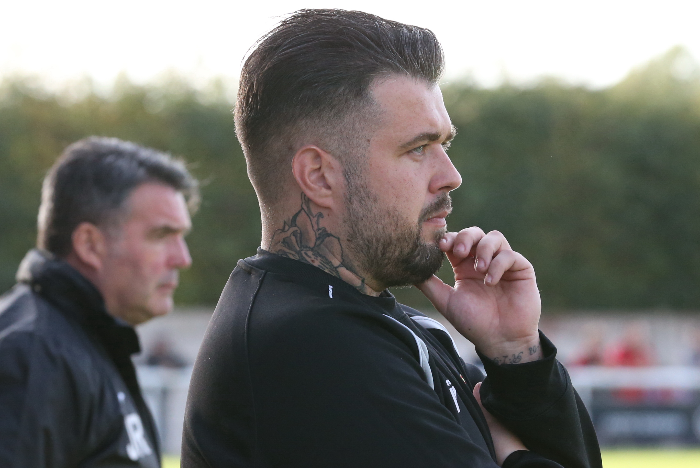kettering boss Marcus Law and Nantwich boss (background) Dave Cooke
