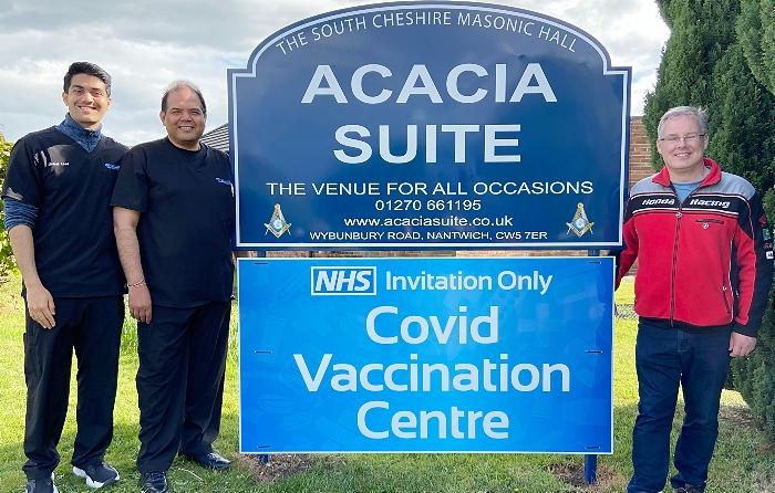 l-r Jainil Patel - Raj Patel MBE - Roger Morris by Acacia Suite (Masonic Hall Willaston) Covid Vaccination Centre signage (1)