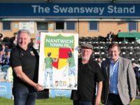 Nantwich artist Tony donates artwork to Nantwich Town FC