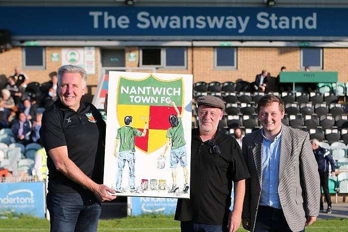 l-r Nantwich Town FC chairman Jon Gold receives artwork from Tony Denton and son Harvey (1)