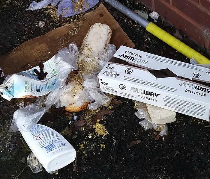 litter spilling out of swine market bins