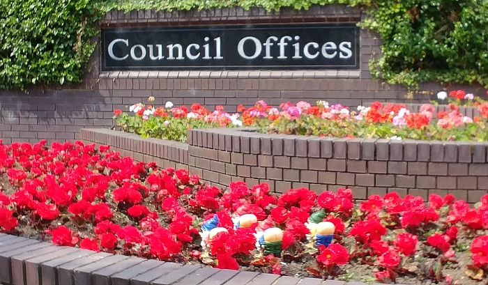 mooning gnomes outside council buildings