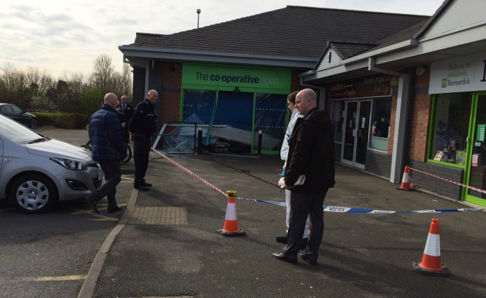 police forensics at co-operative store cashpoint raid