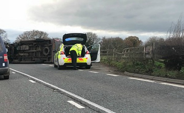 police on scene of overturned car A51 Reaseheath