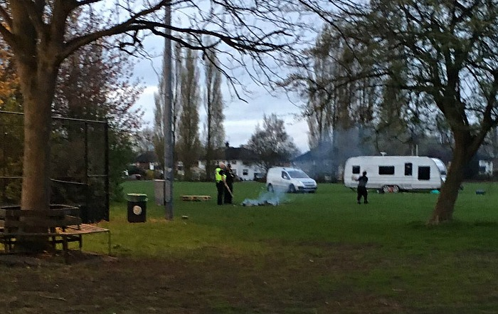 police talk to travellers on Barony Park