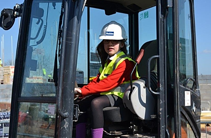 pupils playing on diggers at time capsule tesni event