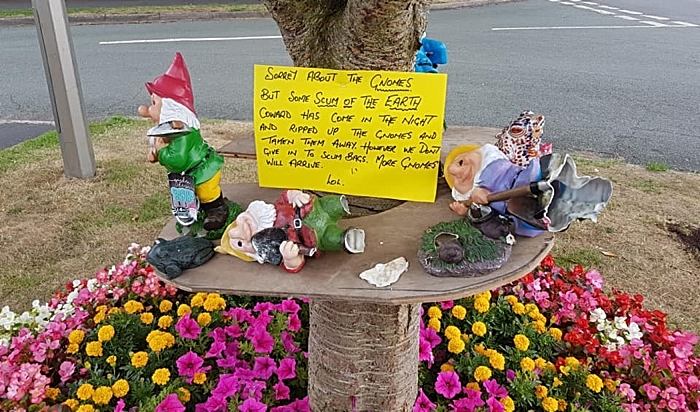 smashed up gnomes in Wistaston