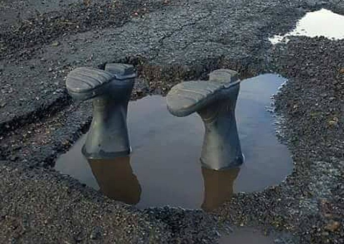 very deep pothole - pic by Nige Smith