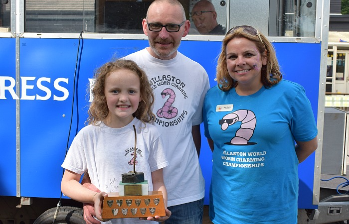 worm charming - Championship trophy for Most Worms - Hope Smith with Dad Matt Smith and Willaston Primary Academy Headteacher Clare Grehan